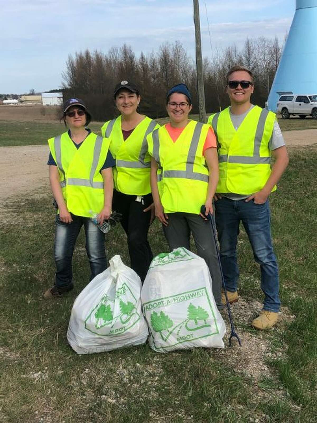 Representatives from Ice Mountain take to the streets along U.S. 10 in Evart on Monday for the Earth Day Adopt-A-Highway event. (Courtesy photo)