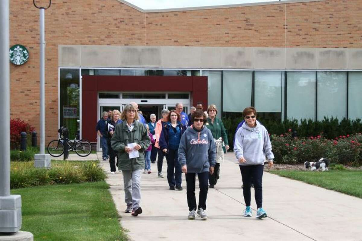 Participants in this year's Big Rapids Area CROP Hunger Walk will meet at the Interdisciplinary Resource Center Connector on the campus of Ferris State University before beginning the event. Pictured, residents set out on the first section of the 2016 walk. (Pioneer file photo)