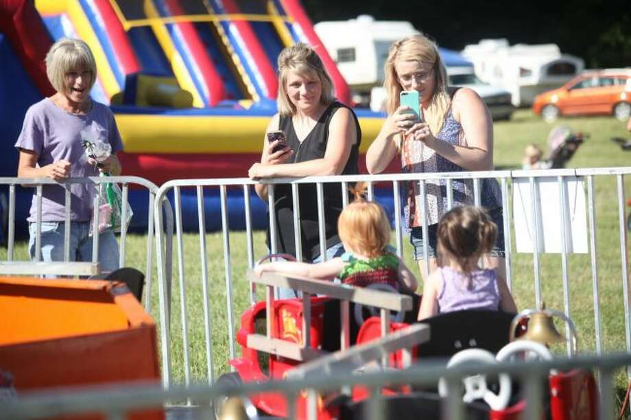 Families enjoy the carnival rides at the 2018 Barryton Lilac Festival. This year's weekend-long festival begins on Friday, May 31, and ends on Sunday, June 2. The event will be filled with a variety of family-friendly activities. (Pioneer file photo)