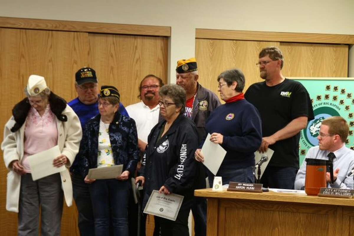 CITIZEN AWARD: Members of the Holland Park Veterans and Homefront Heroes Committee stand to be recognized and receive the Citizens Recognition Award during a recent Big Rapids City Commission meeting. (Pioneer file photo)