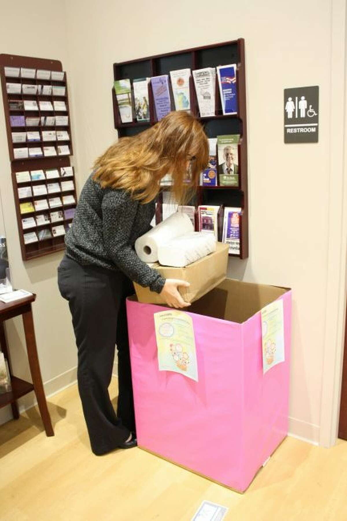 A woman places donated items in the Jaycees Community Donation Drive box in 2017 at the Mecosta County Area Chamber of Commerce office. This year, the Jaycees are running two charitable giving events, with the spring drive beginning Sunday, April 29. (Pioneer file photo)