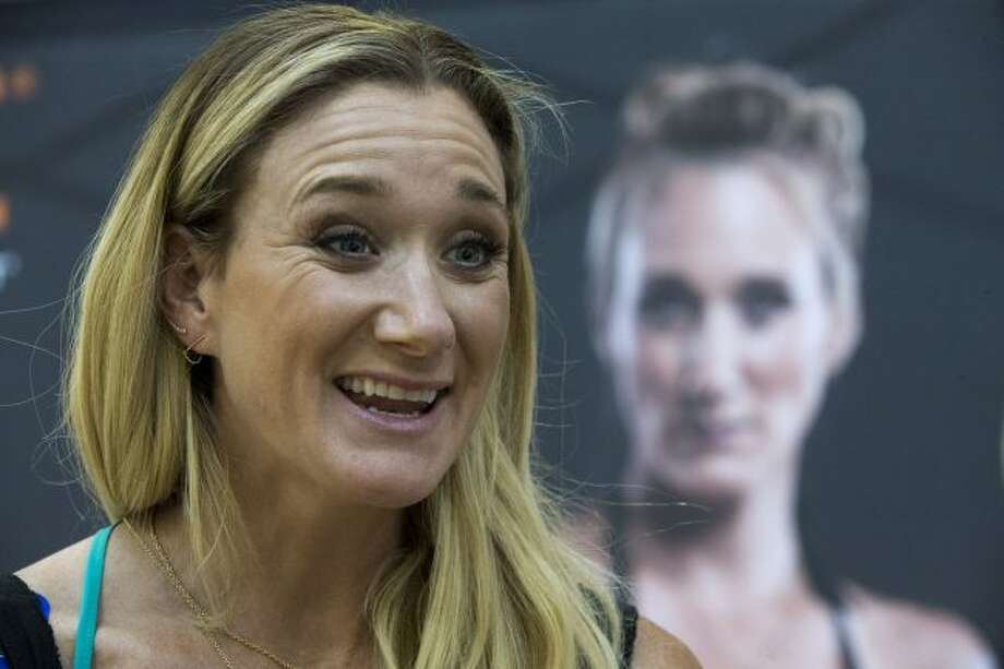 In this March 22, 2016, file photo, Kerri Walsh Jennings speaks to reporters during a news conference in New York. Three-time beach Olympic volleyball gold medalist Kerri Walsh Jennings has a new partner as she tries to qualify for the 2020 Summer Games in Tokyo. Walsh Jennings tells The Associated Press she will pair with Rio Olympian Brooke Sweat, a defensive specialist. (AP Photo/Mary Altaffer, File)