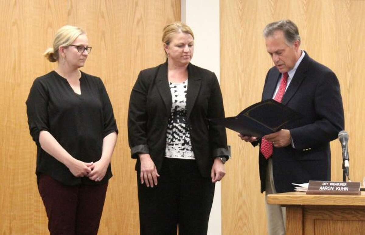 (From left to right) Mecosta County Chamber of Commerce Programming and Events Coordinator Megan Eppley and Executive Director Jennifer Heinzman are recognized by Big Rapids Mayor Mark Warba and the City Commission during Monday's meeting as part of Michigan Chamber of Commerce Month. (Pioneer photo/Brandon Fountain)