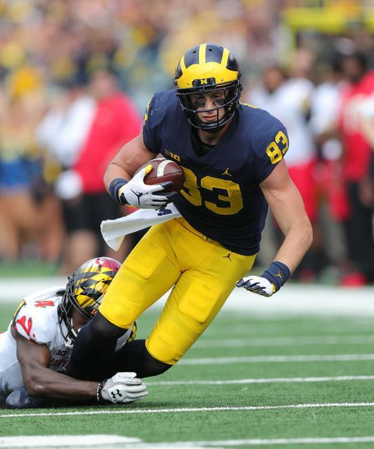 Michigan's Zach Gentry is tackled by Maryland's Darnell Savage Jr. during the first half Saturday. (Photo: Kirthmon F. Dozier, Detroit Free Press)