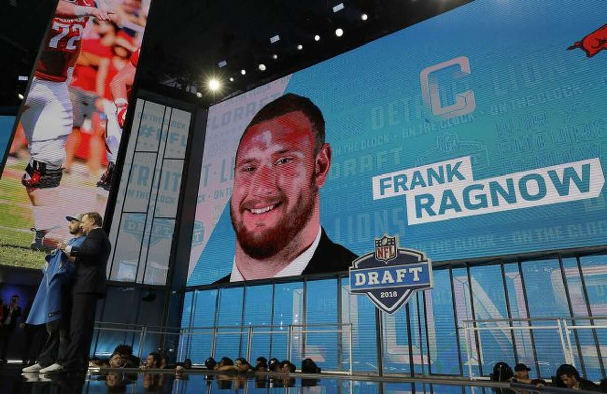 Commissioner Roger Goodell, left, poses with a fan after the Detroit Lions selected Frank Ragnow during the first round of the NFL football draft, Thursday, April 26, 2018, in Arlington, Texas. (AP Photo/David J. Phillip)