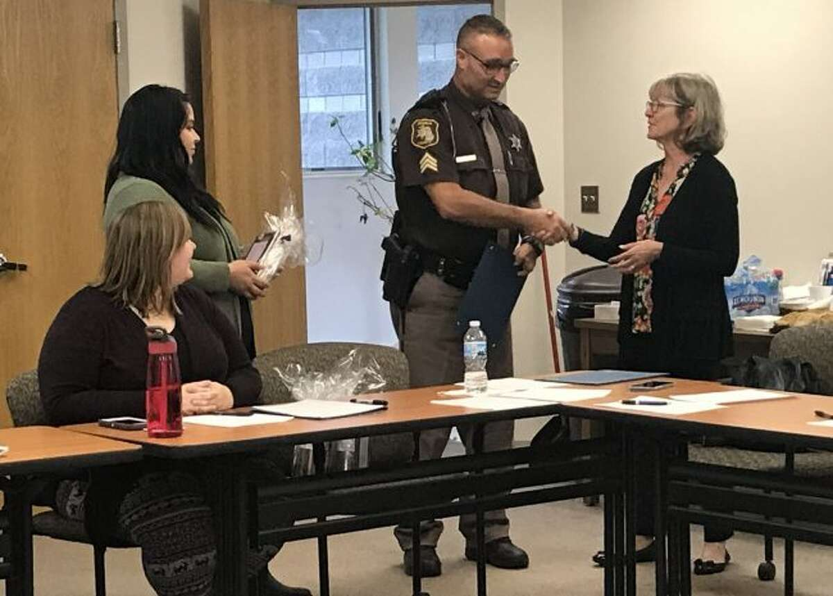 Sergeant Gary Hooper, with the Osceola County Sheriff's Department, was one of several local law enforcement officers to receive a token of appreciation from Women's Information Service, Inc. members on Wednesday.