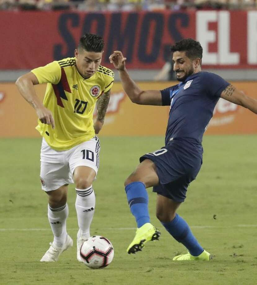 Colombia's James Rodriguez (10) moves the ball past Unites States' Kenny Saief during the first half of an international friendly soccer match Thursday, Oct. 11, 2018, in Tampa, Fla. (AP Photo/John Raoux)