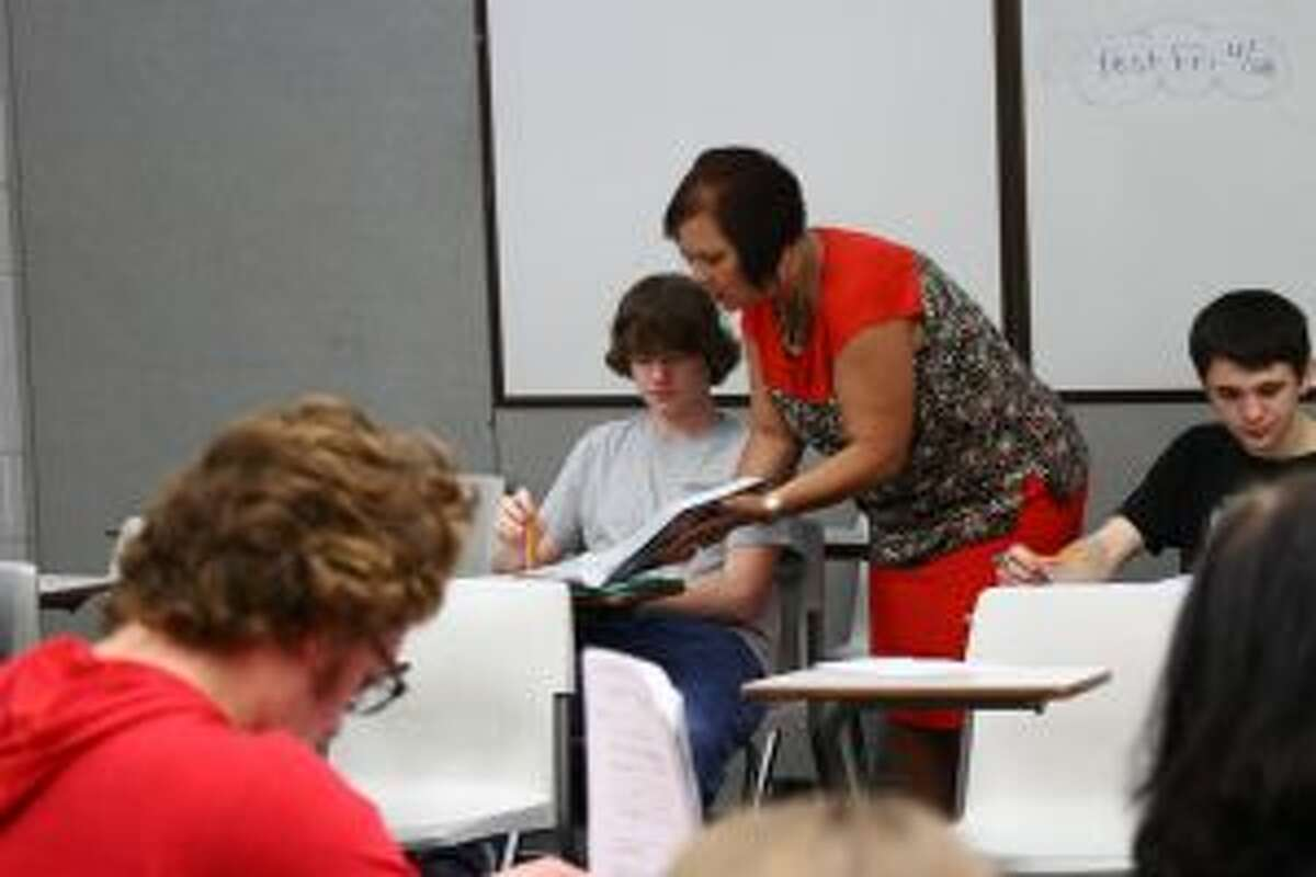 TEACHING LESSONS: BRHS teacher Kathleen Murray works with a student in class.