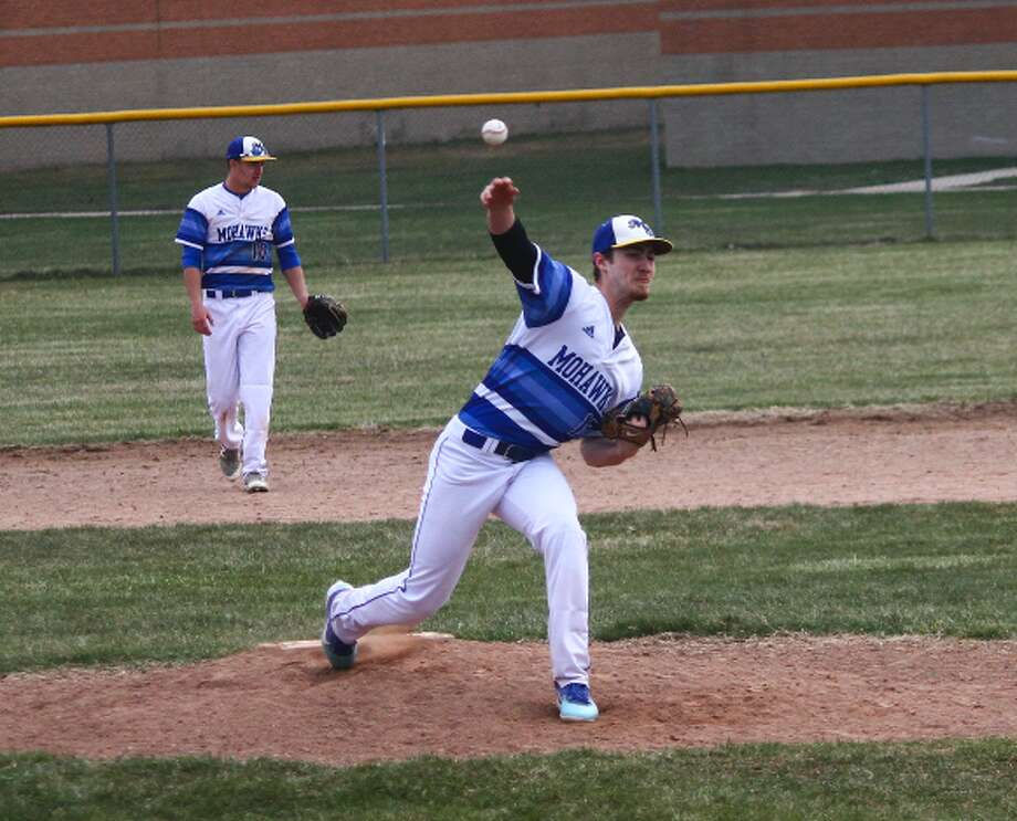 Landon Elenbaas rifles a pitch during Friday's game. (Pioneer photo/Maxwell Harden.)