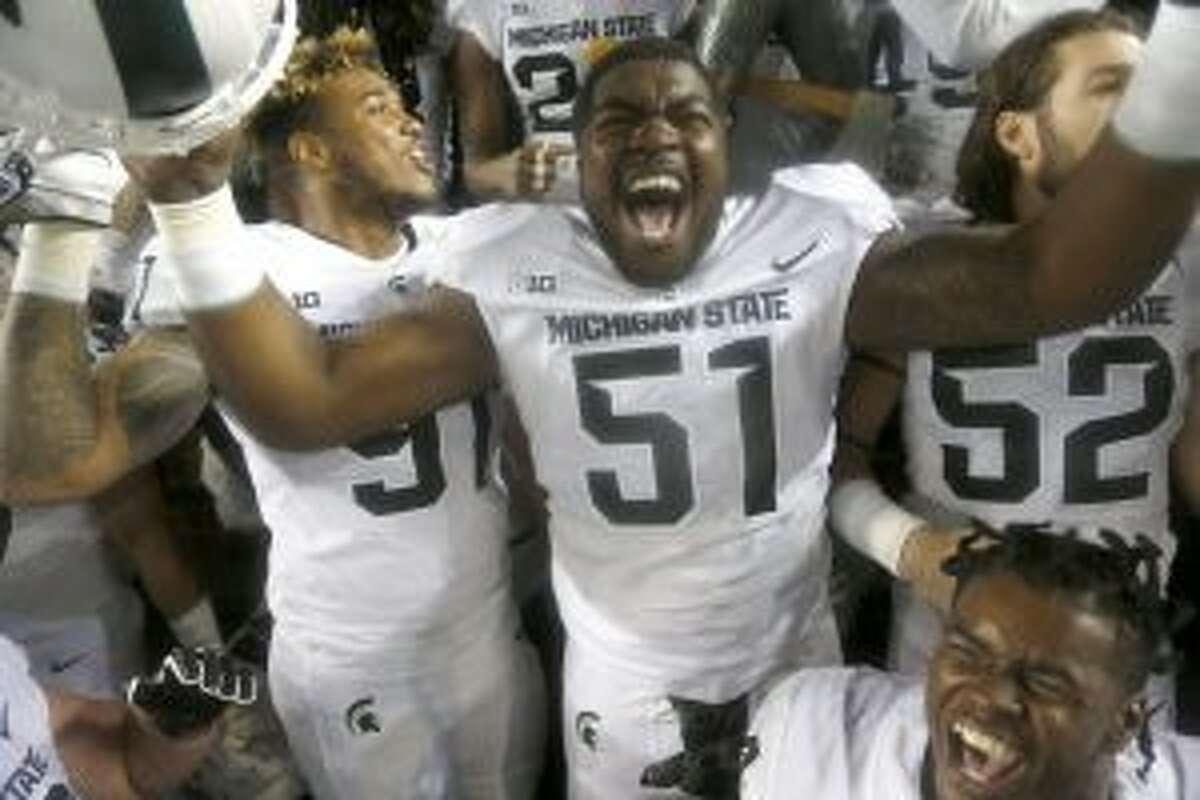 Michigan State players celebrate.
