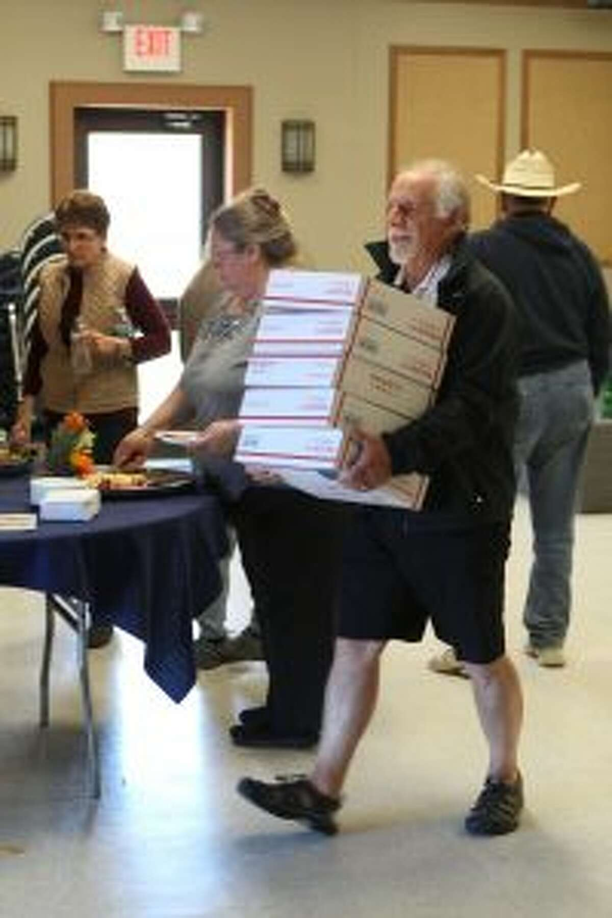 Dozens and dozens of U.S. Postal Service boxes were packed during Monday's Jerky for Troops event at CK's Place, south of Big Rapids. The annual event helps serve as a morale booster to local service members and their comrades who are stationed throughout the world.