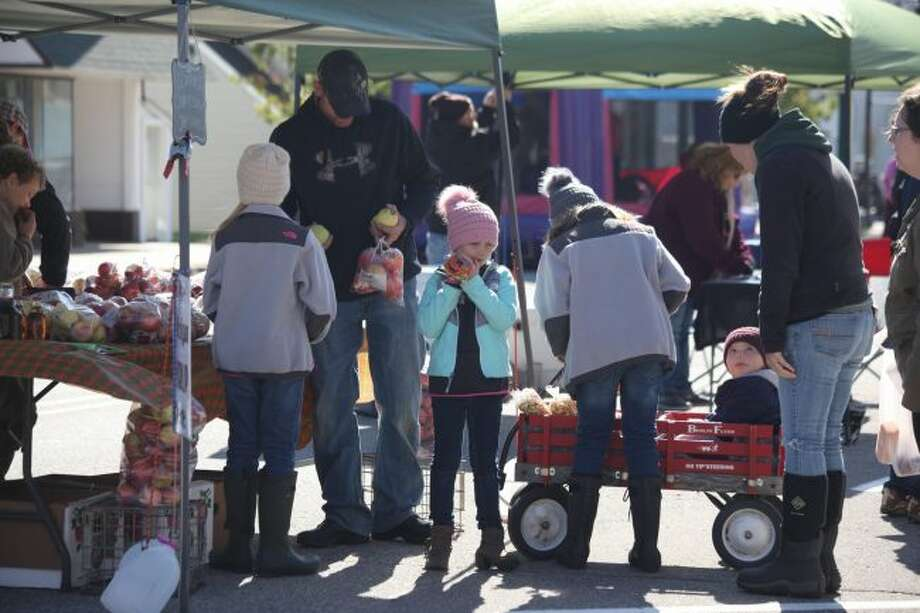 Community members of all ages gathered on Saturday for the annual Evart Main Street Fall Festival. Friends and families enjoyed the nice fall weather by visiting craft and food vendors, playing carnival games and jumping in bouncy castles. (Pioneer photos/Taylor Fussman)