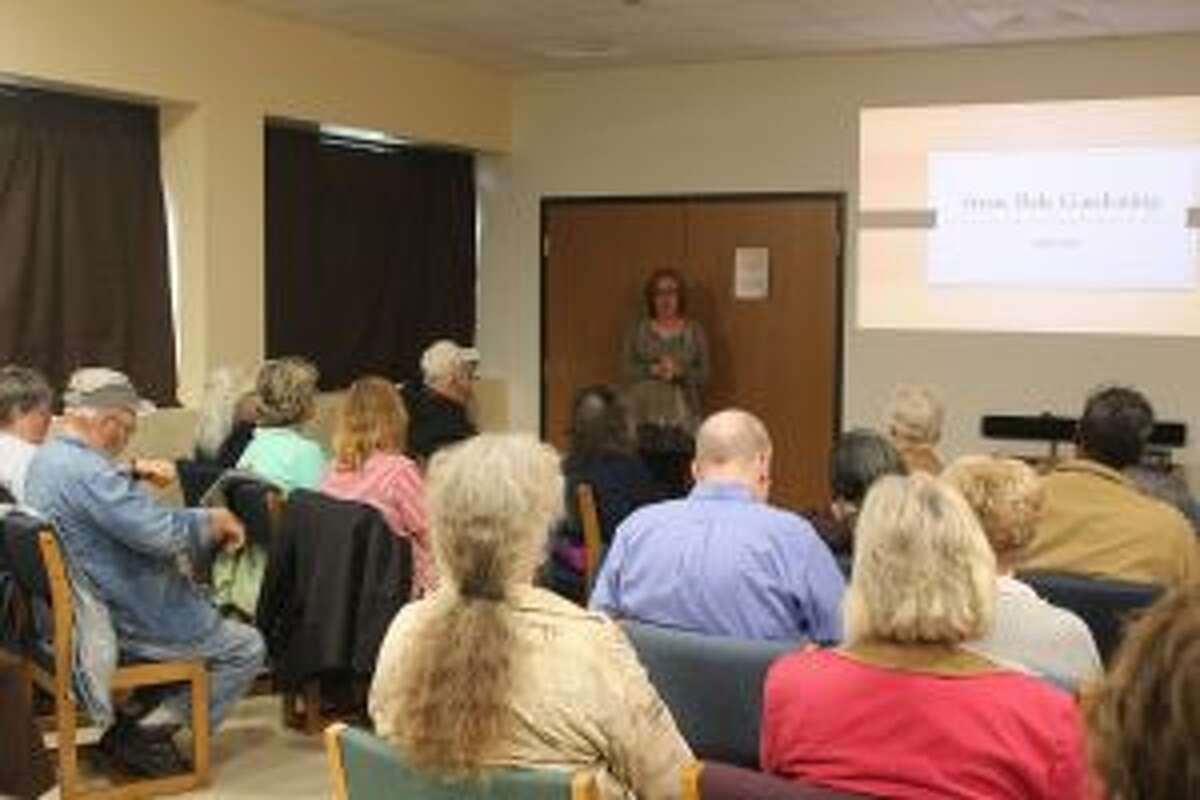 LEARNING: Carlleen Rose, of Big Rapids, presents a class about straw bale gardening to residents on Thursday evening at the Reed City Area District Library.