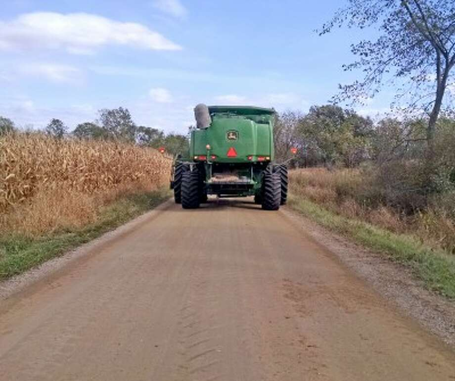 As harvest season begins in Mecosta County, officials advise drivers to slow down and be mindful of farm equipment on the roads. (Courtesy photo/Marilyn Thelen, MSU Extension)