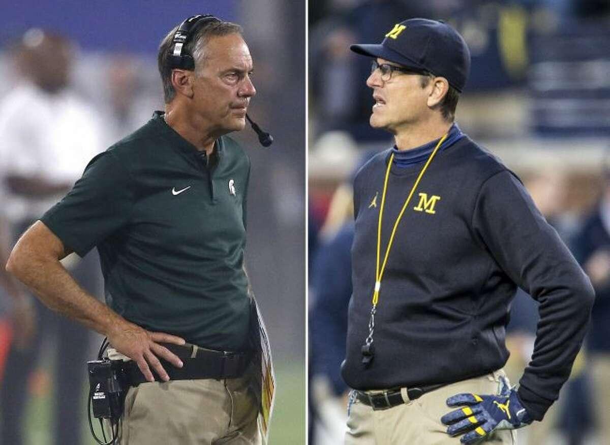Jim Harbaugh (left) and No. 6 Michigan plays Mark Dantonio and No. 24 Michigan State in East Lansing on Saturday. (AP Photo/File)
