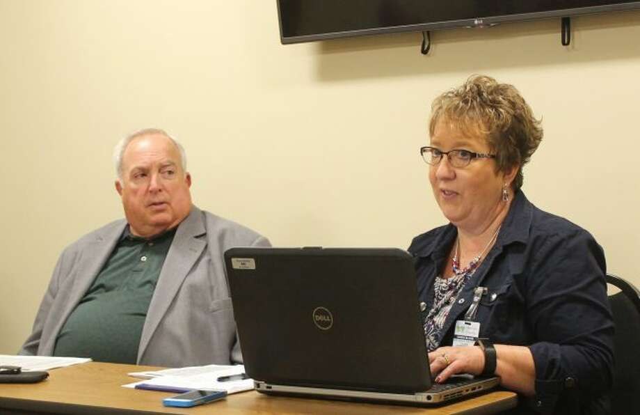 Osceola County Commissioner Larry Emig (left) and Clerk Karen Bluhm listen as Treasurer Lori Leudeman (not pictured) discusses the high costs of health insurance during a special work session meeting of officials and county commissioners to work on the 2018 general fund budget. Initially tasked with nearly $2 million more in expenditures than revenue, revisions and utilizing nearly $900,000 in fund balance now leaves a shortfall of $420,000 in the 2018 general fund budget. (Pioneer photo/Brandon Fountain)