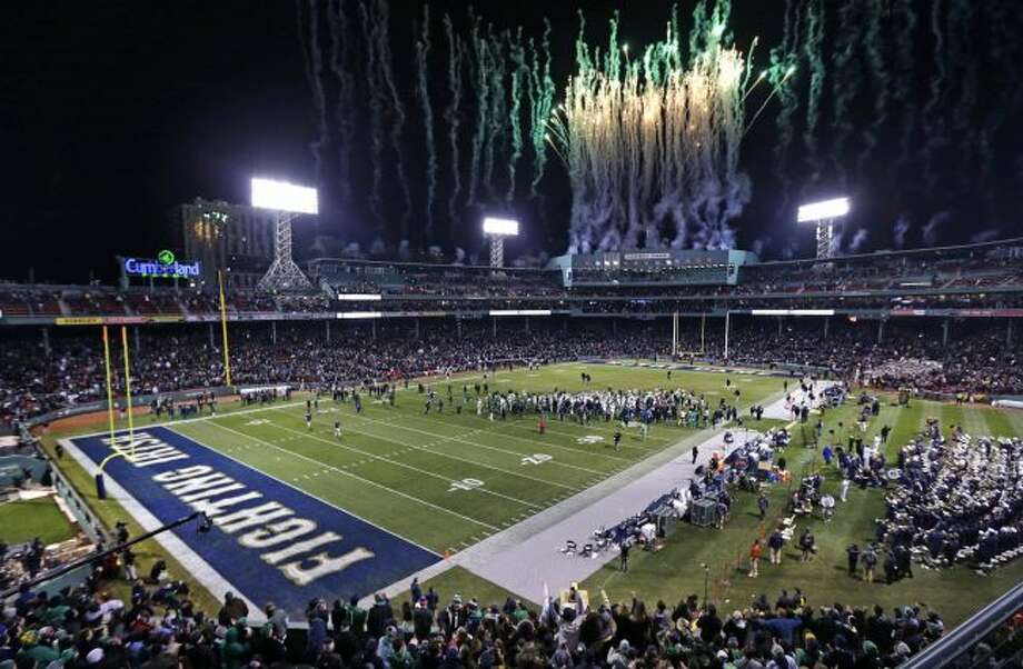 In this Nov. 21, 2015 file photo, fireworks light up the sky at the conclusion of the Shamrock Series NCAA college football game between Notre Dame defeated Boston College at Fenway Park, home of the Boston Red Sox baseball club in Boston. Yale will play Harvard in November at Fenway Park, for the 135th edition of the rivalry. (AP Photo/Charles Krupa File)