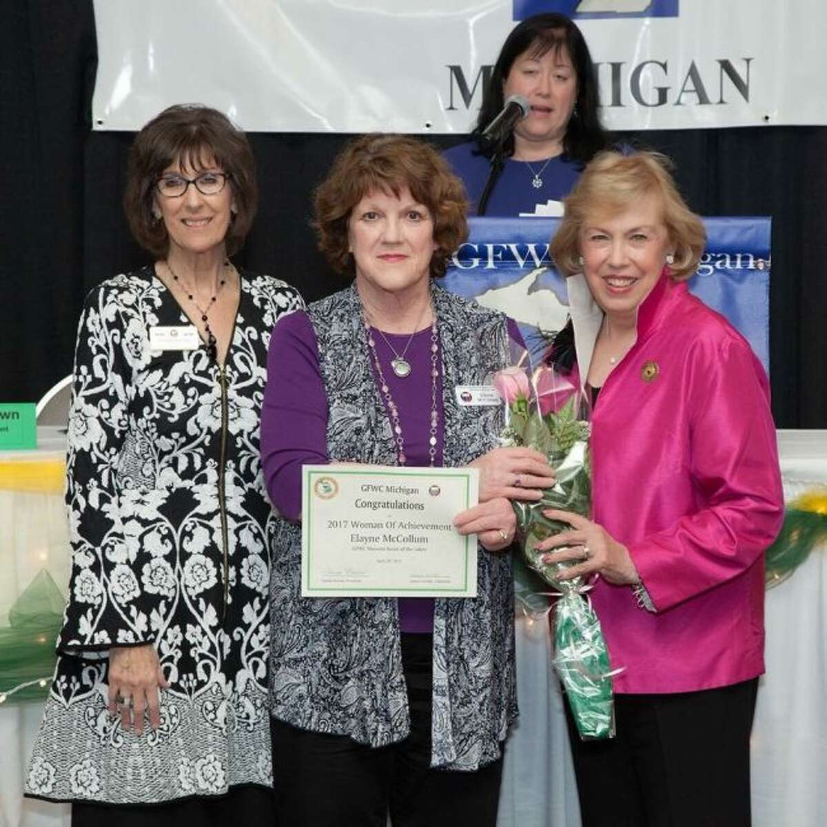 Pictured are (from left) Donna Brown, General Federation of Women's Clubs Michigan president; Elayne McCollum, GFWC Mecosta - Heart of the Lakes 2017 Woman of Achievement; Mary Ellen Brock, GFWC International president-elect; and (at podium) Laurie Geralds, Madison Heights women's club president. (Courtesy photo)
