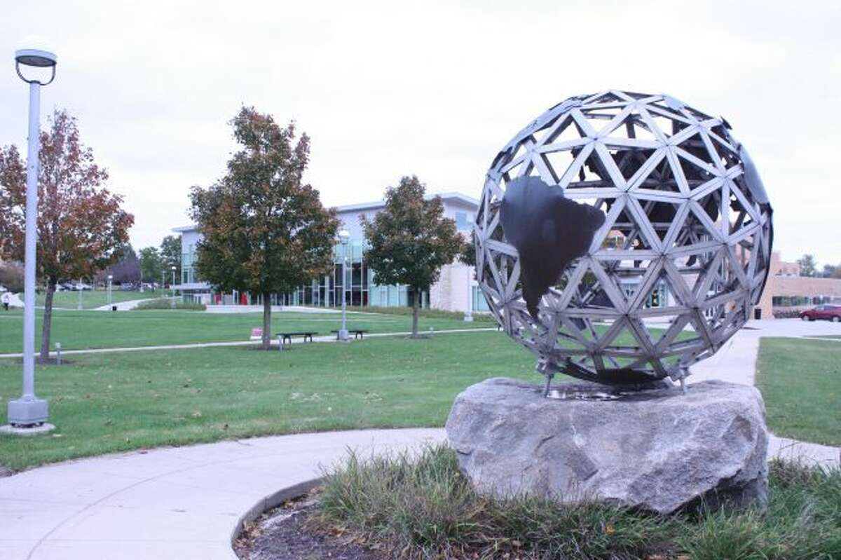 The Ferris State University world monument is pictured Wednesday. Some expert university students across the state to turn out en masse for the Nov. 6 midterm election, which would buck a trend if it were to happen. (Pioneer photo/Tim Rath)