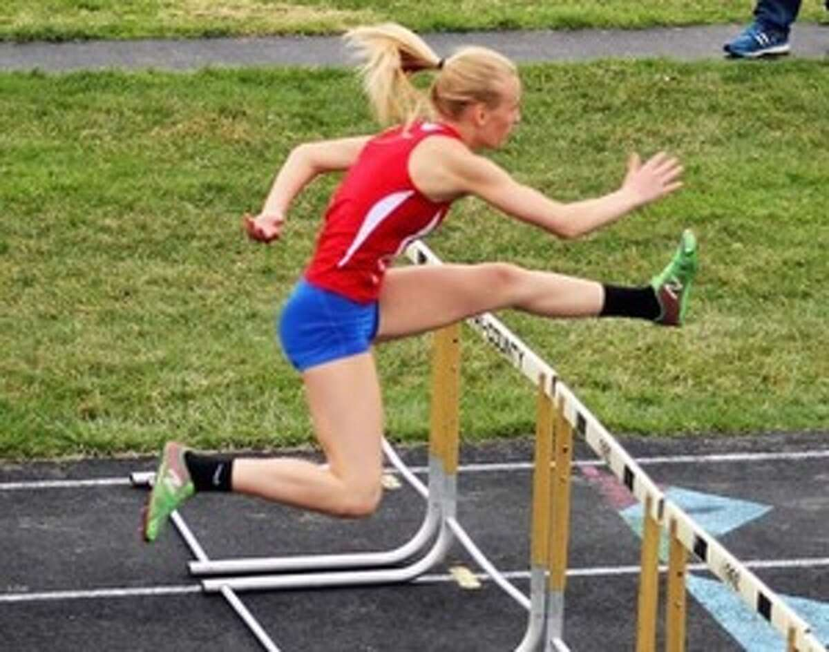 Harley Flachs competes in a hurdle event for Chippewa Hills High School track and field team. Flachs is raising money to travel to Australia and compete with the Down Under Sports program. (Courtesy photo)