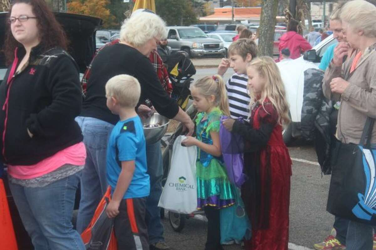 Children go through the trunk-or-treat line during the 2016 Fall Festival. This year, the trunk-or-treat will be in the street in the 100 block of North Michigan Avenue, which will be closed for the festival. (Pioneer file photo)