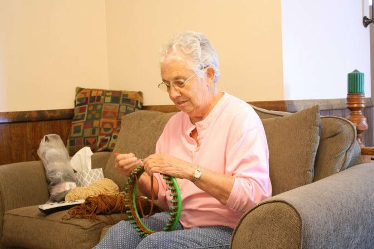 Sara Ham has given away more than 100 hats through the Manna Pantry in Big Rapids. She knits the hats in the evenings while she watches television. (Pioneer photo/Candy Allan)