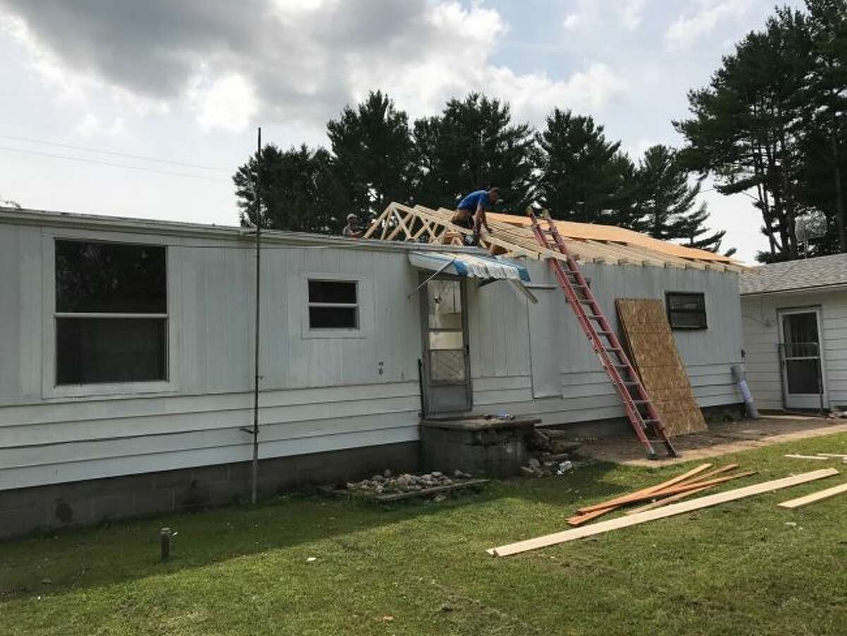 Members of the Mecosta County Habitat for Humanity are attempting to reach out and offer assistance to local military veterans through Veterans Program, a Habitat for Humanity initiative which specifically aims to help veterans in the county by providing critical home repair or home modification services - such as installing wheelchair ramps. (Courtesy photo)