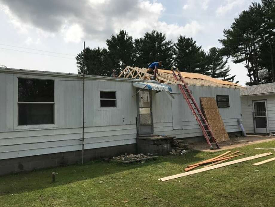Members of the Mecosta County Habitat for Humanity are attempting to reach out and offer assistance to local military veterans through Veterans Program, a Habitat for Humanity initiative which specifically aims to help veterans in the county by providing critical home repair or home modification services — such as installing wheelchair ramps. (Courtesy photo)