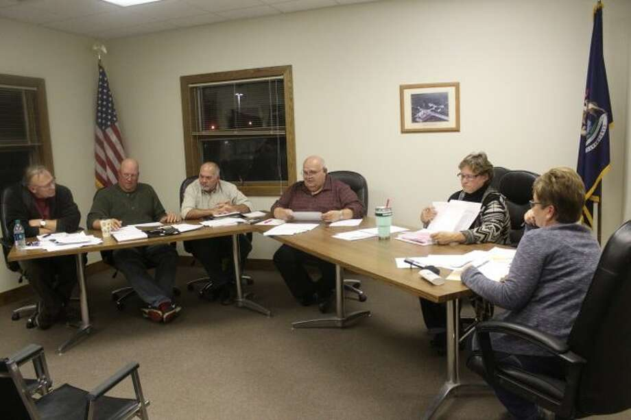 (From left to right) Big Rapids Charter Township Board of Trustees Jerry Everett, Tony Geib, Carman Bean, Supervisor Bill Stanek, Treasurer Penny Currie and Clerk Rene Fountain discuss the township's 2018 projected budget during Thursday's special meeting. Officials expect to use some of the general fund's fund balance to increase money for road projects in 2018. The board also set its annual budget hearing for 6:30 p.m. on Tuesday, Nov. 7. (Pioneer photo/Brandon Fountain)