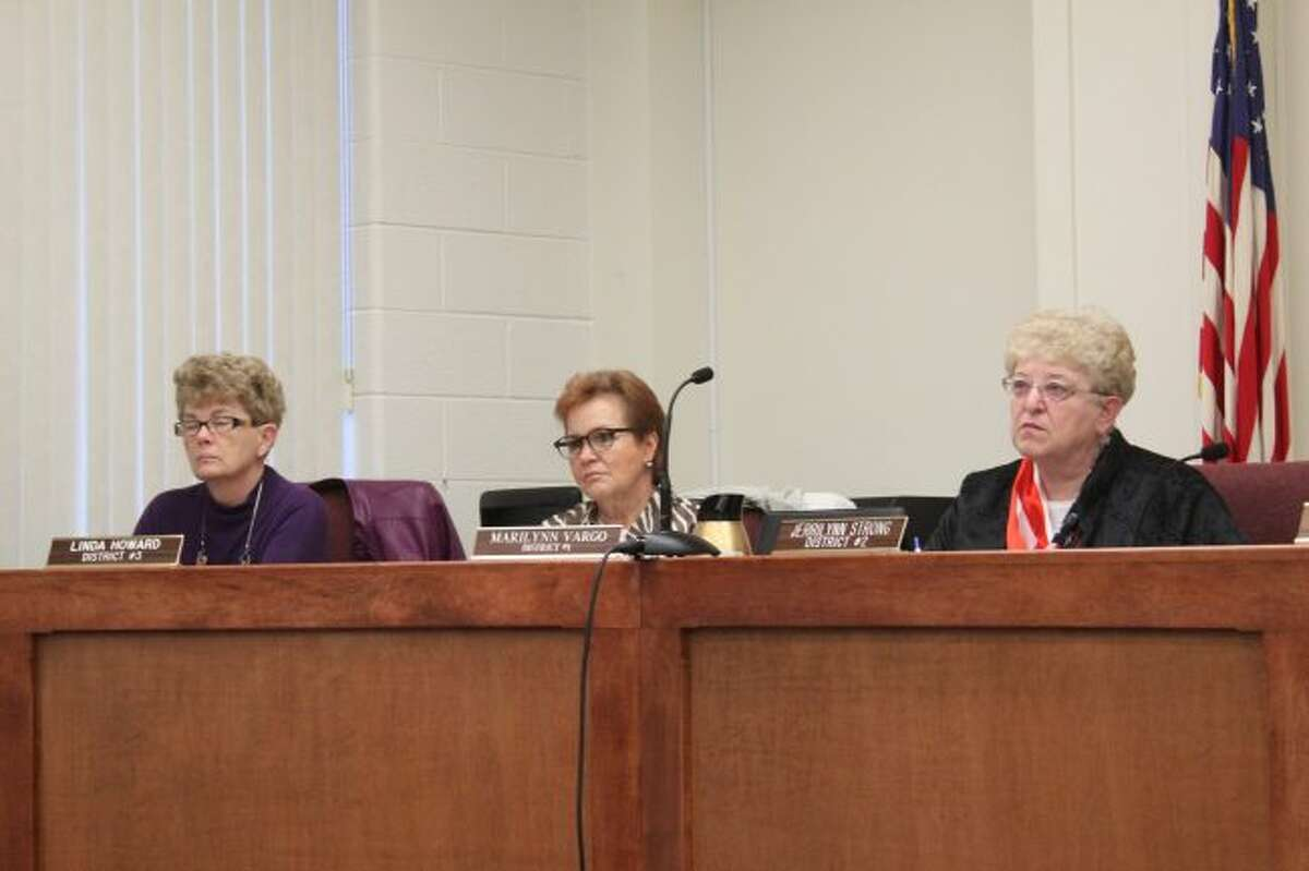 (From left to right) Mecosta County Commissioners Linda Howard, Marilynn Vargo and Jerrilynn Strong listen to a presentation during Thursday's Mecosta County Board of Commissioners meeting. Commissioners heard an update about the West Michigan Forensic Pathology Services Authority. (Pioneer photo/Brandon Fountain)