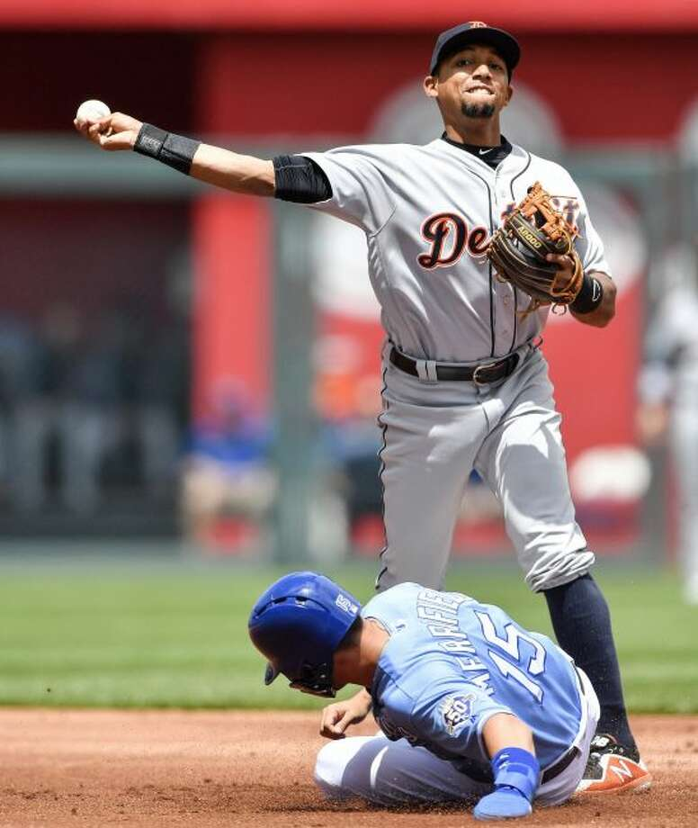 Detroit Tigers shortstop Dixon Machado forces out Kansas City Royals' Whit Merrifield at second but couldn't complete the double play on Jorge Soler in the first inning of a baseball game at Kauffman Stadium in Kansas City, Mo., Thursday, May 3, 2018. (John Sleezer/The Kansas City Star via AP)
