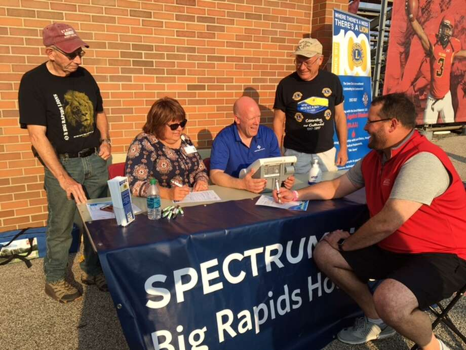 Pictured at an outreach event are (from left) Bill Simpson, Big Rapids Lions Club; Beth Langenberg and Scott Lombard, Spectrum Health Big Rapids and Reed City Hospitals; and Denny Finney, Big Rapids Lions Club. Seated in front is James Nostrant. (Courtesy photo)
