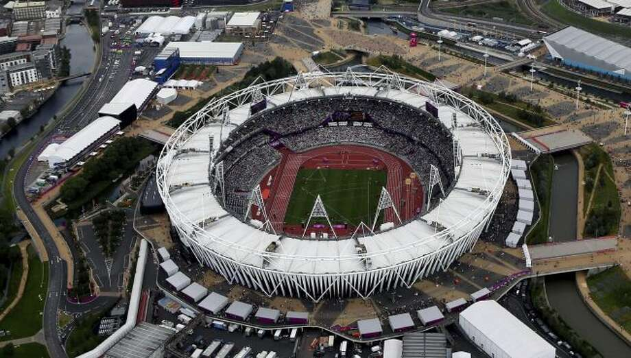 This Aug. 3, 2012, aerial file photo shows the Olympic Stadium at Olympic Park, in London. A person familiar with the planning tells The Associated Press that Major League Baseball intends to announce next week plans have been finalized to have the New York Yankees and Boston Red Sox play a two-game series at London's Olympic Stadium on June 29-30 next year. The person spoke on condition of anonymity Thursday, May 3, 2018, because no public comments were authorized. These will be the first regular-season MLB games in Europe. The Red Sox will be the home team for the both games. (AP Photo/Jeff J Mitchell, File)