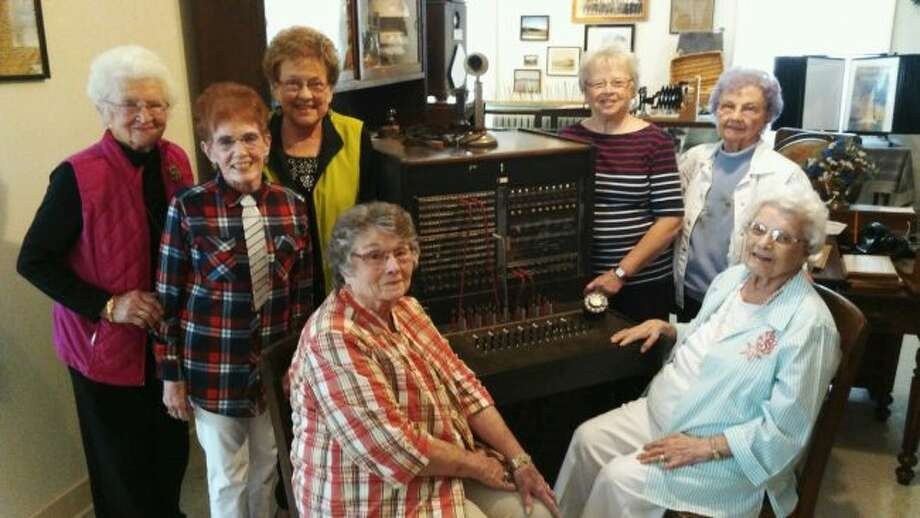 Former Michigan Bell Telephone operators met for a reunion on Oct. 7 at the Mecosta County Museum. Pictured next to one of the switchboards they used are: (standing, from left) Noreen Kehr, Katy Schuberg, Marilyn Schippa, Peggy Brennan, Mary Therese Smith, (seated) Dorothy Birtles and Agnes Tornblom. (Courtesy photo)