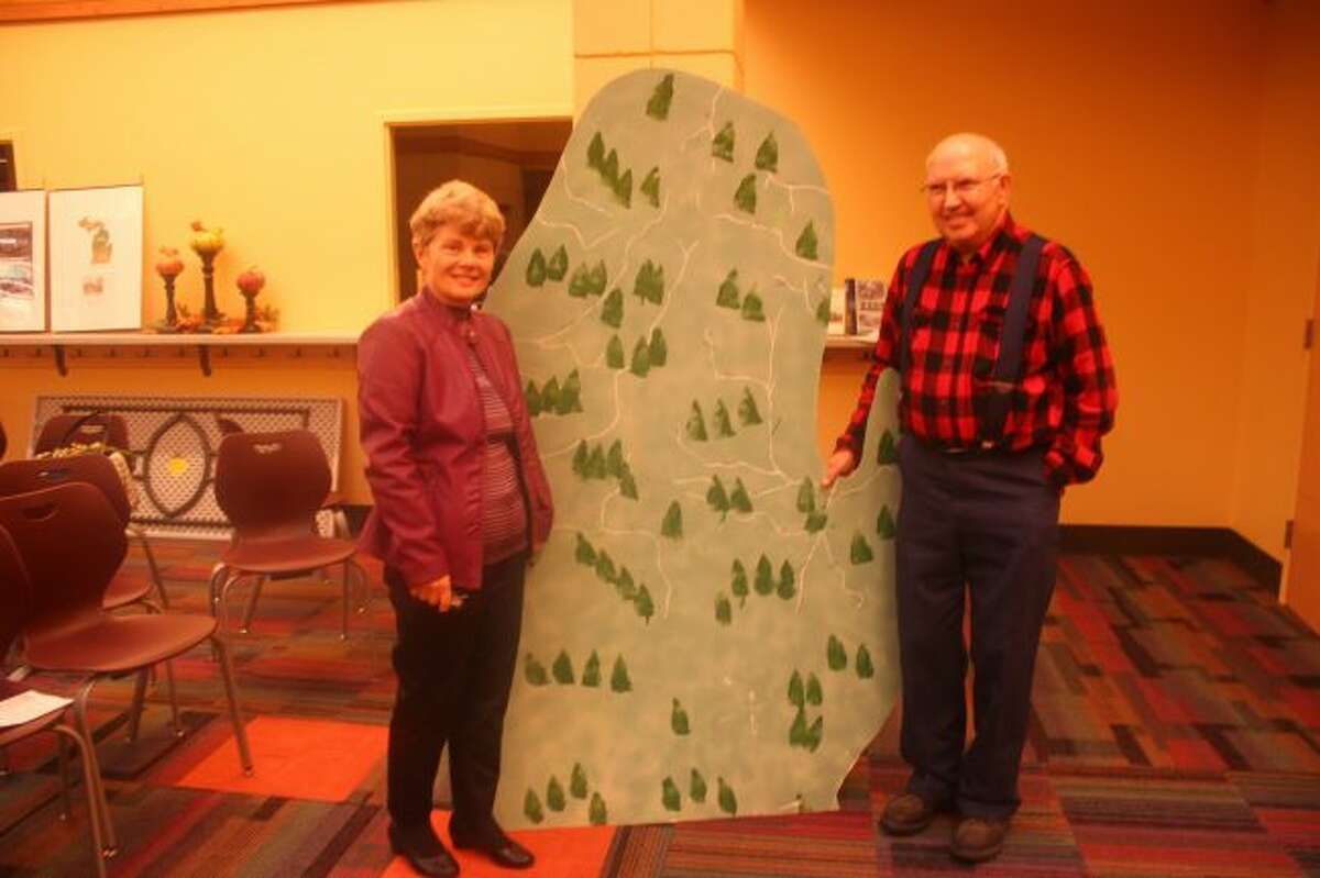 Linda Howard and Pine Pitch Pete presented during the Mecosta Book Village program, Mecosta's Logging Trails. (Pioneer photo/Shanna Avery)