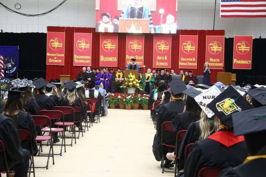 Ferris State University President David Eisler addresses the graduates and their families during Friday's ceremony for the College of Health Professions and Michigan College of Optometry. (Pioneer photos/Emily Grove)