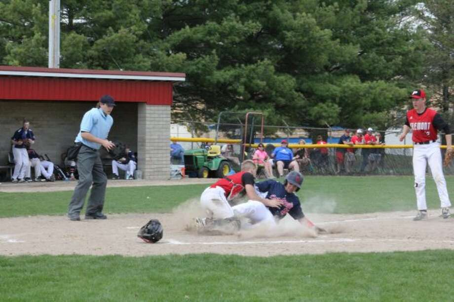 Big Rapids' Connor Vennix slides into home plate but is tagged out.