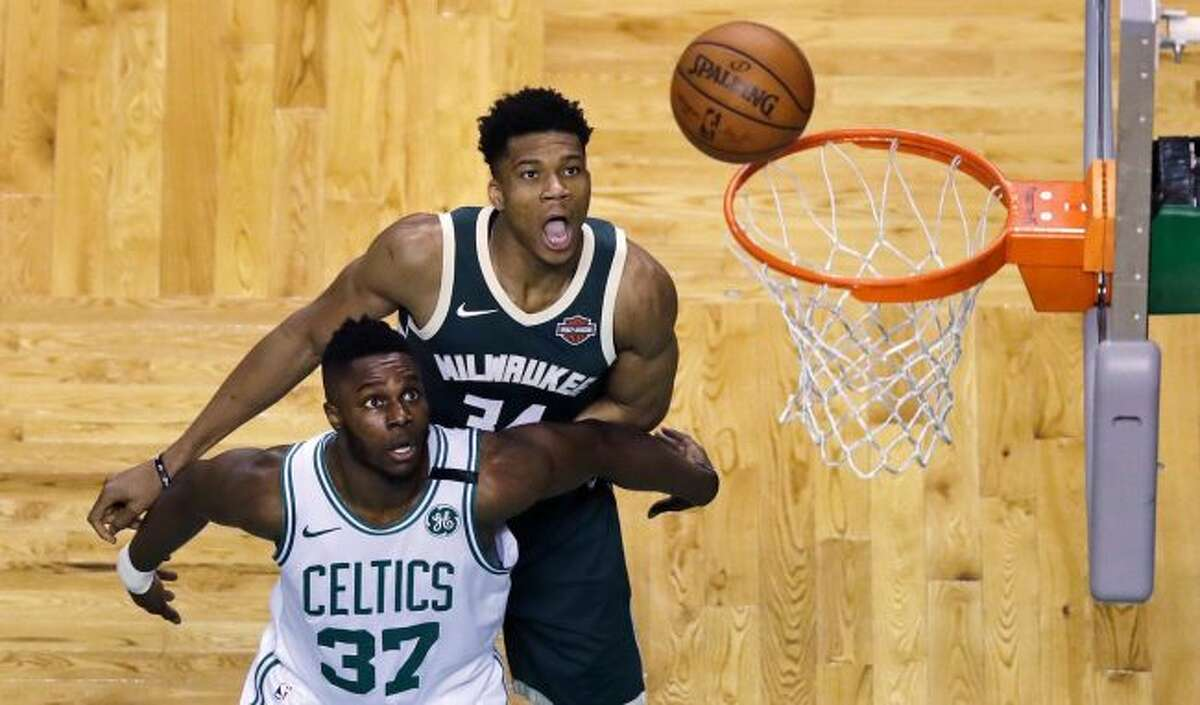 Boston Celtics forward Semi Ojeleye (37) blocks out Milwaukee Bucks forward Giannis Antetokounmpo (34) as they wait for a rebound during the first quarter of Game 7 of an NBA basketball first-round playoff series in Boston, Saturday, April 28, 2018. (AP Photo/Charles Krupa)