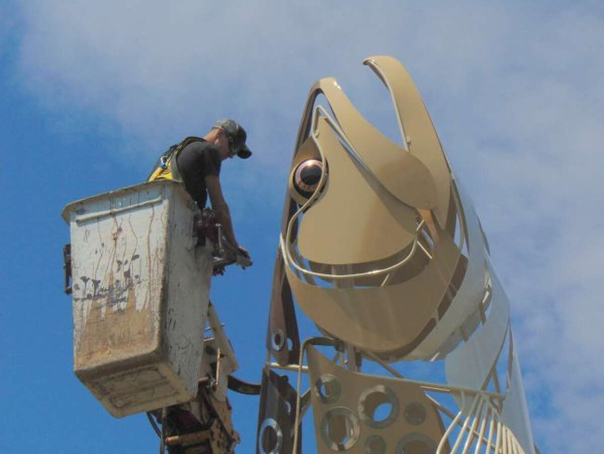 The world's largest brown trout sculpture was installed Sunday afternoon in downtown Baldwin. (Pioneer photo/Shanna Avery)