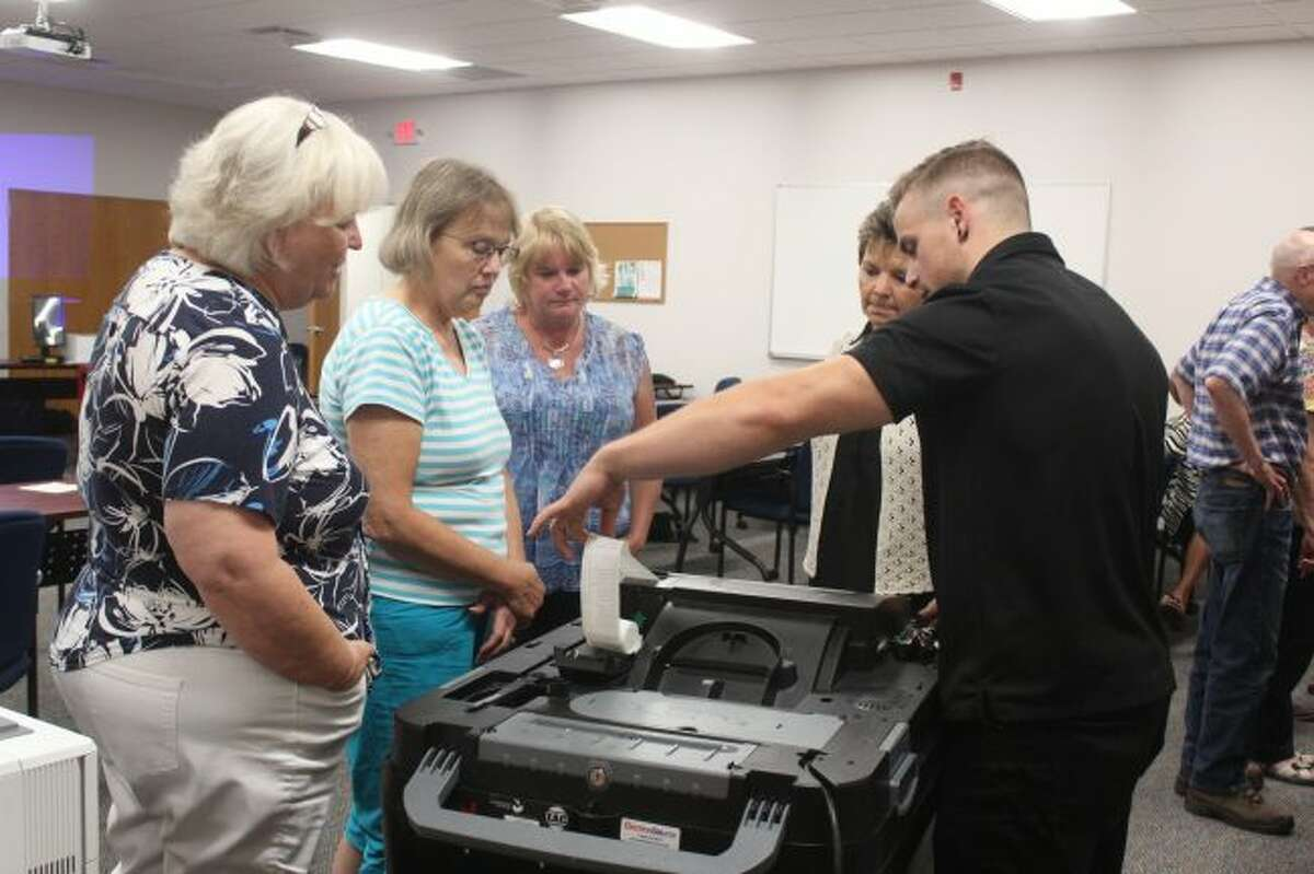 Mecosta County township clerks and deputy clerks receive hands-on training for the new Dominion Voting machines during a training session in August. City and Big Rapids Public Schools voters will used the new machines at the Tuesday, Nov. 7, election. (Pioneer File Photo)