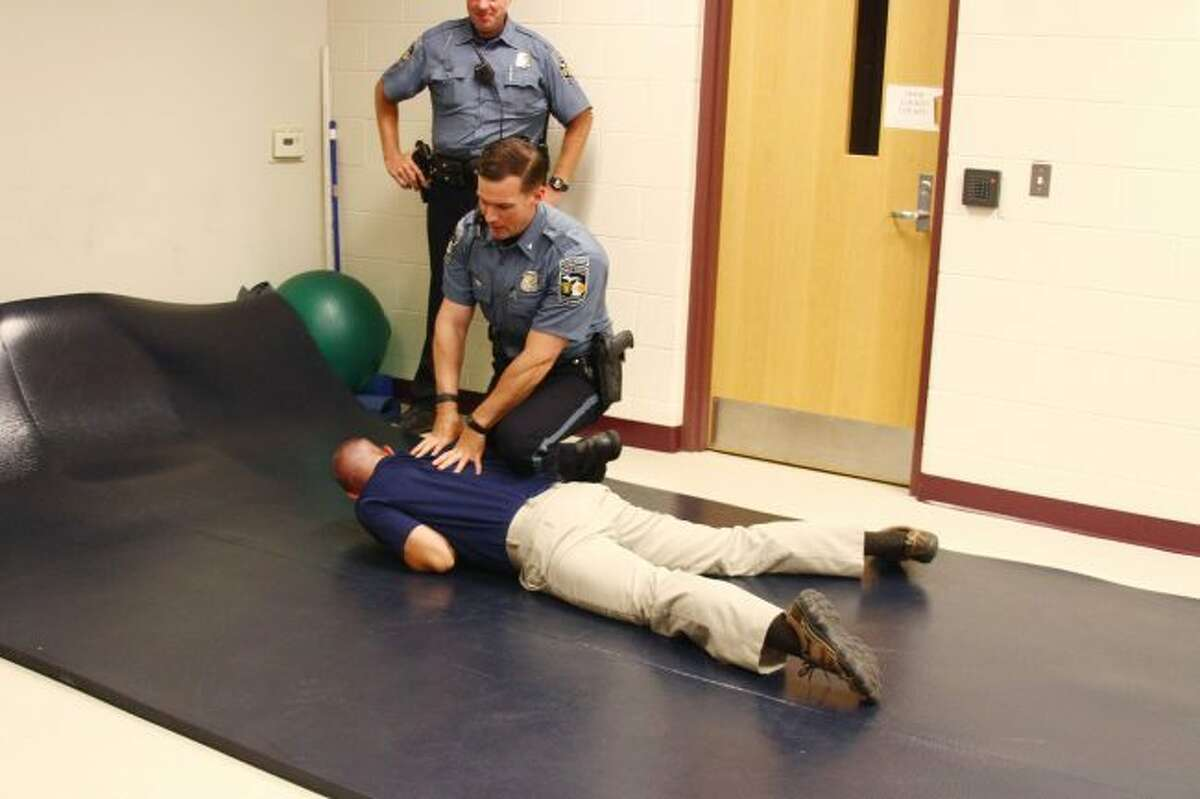 Big Rapids Department of Public Safety Director Jim Eddinger is restrained by Officer Tyler Haynes during a demonstration about techniques for using force. (Pioneer file photo)