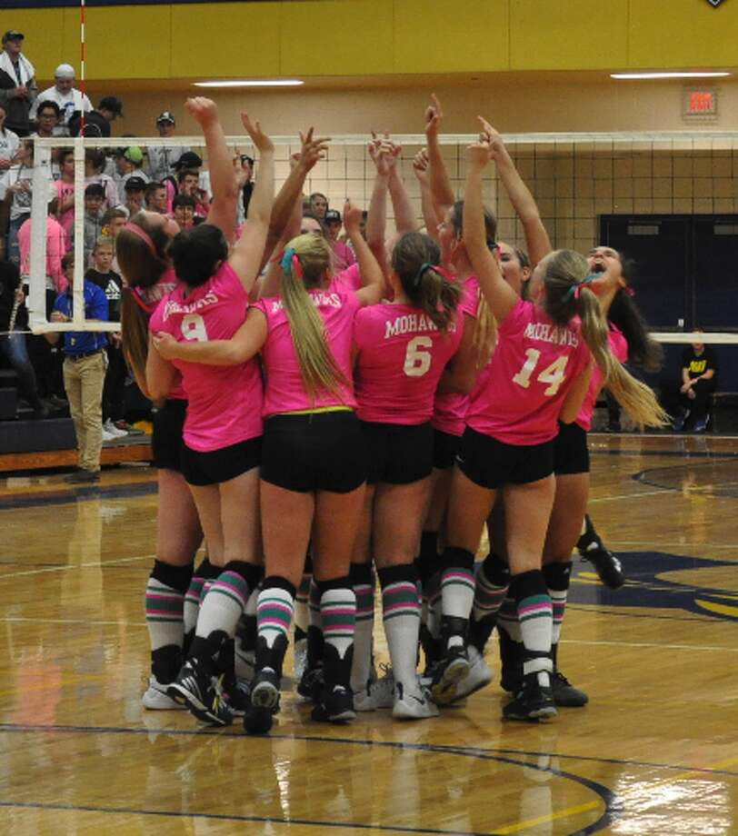 The Morley Stanwood volleyball team celebrates following its 3-2 victory over Hesperia in its Teal Attack Match. The Mohawks clinched the outright CSAA Silver title. (Courtesy photo/Tracy Waldo)