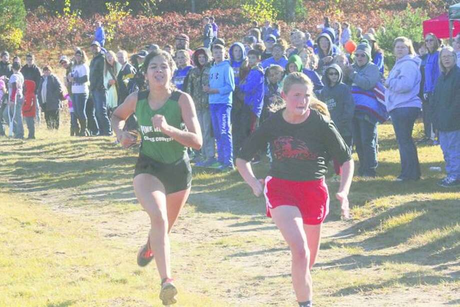 Pine River's Anselma Barnett (left) was ninth in Tuesday's Highland Conference race. (Pioneer photo/John Raffel)