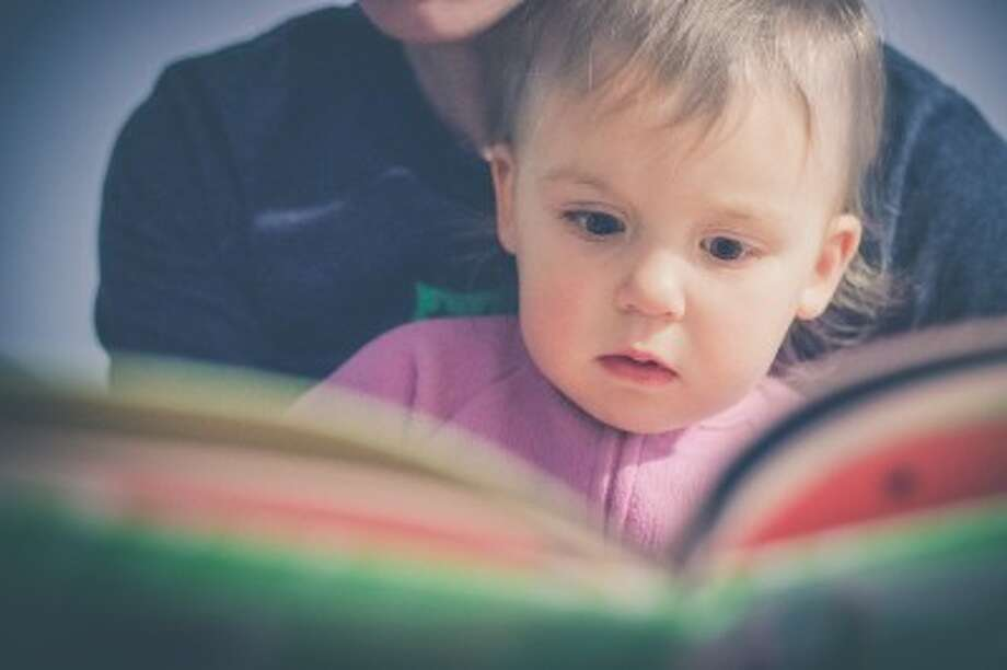 Reading to babies is important to the brain development occurring during the first three years of life. (Courtesy photo)