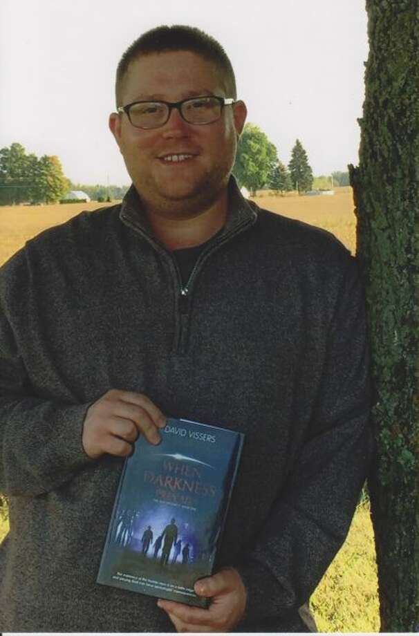 """David Vissers II, who attended Big Rapids High School, recently released """"When Darkness Prevails,"""" the first book of the Zeir Prophecy series. (Courtesy photo)"""