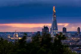St. Paul's Cathedral, left and The Shard stand out in relief against the darkening London skyline on May 20, 2017.