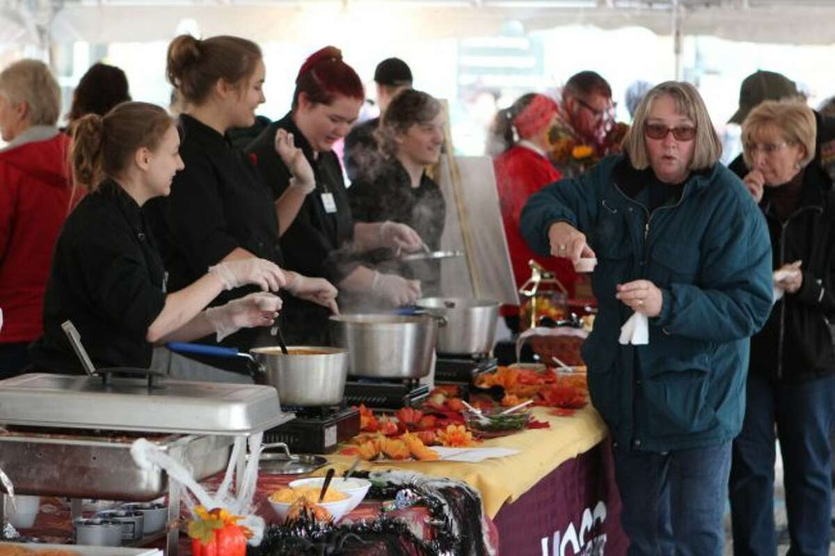 The Big Rapids Downtown Business Association's annual chili cook-off kicks off the annual Fall Festival. Hundreds of people sampled chili from local restaurants, caterers and businesses, and voted their favorite. (Pioneer photos/Brandon Fountain)