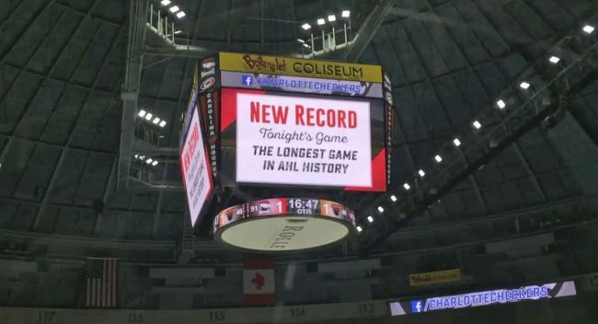 In this photo taken from video the scoreboard at Bojangles Coliseum shows a new record for the longest game in AHL hockey history at a playoff game between the Charlotte Checkers and the Lehigh Valley Phantoms in Charlotte, N.C., early Thursday morning, May 10, 2018. Lehigh Valley won 2-1 in the fifth overtime. (AP Photo/Jeff Siner, Charlotte Observer via AP)