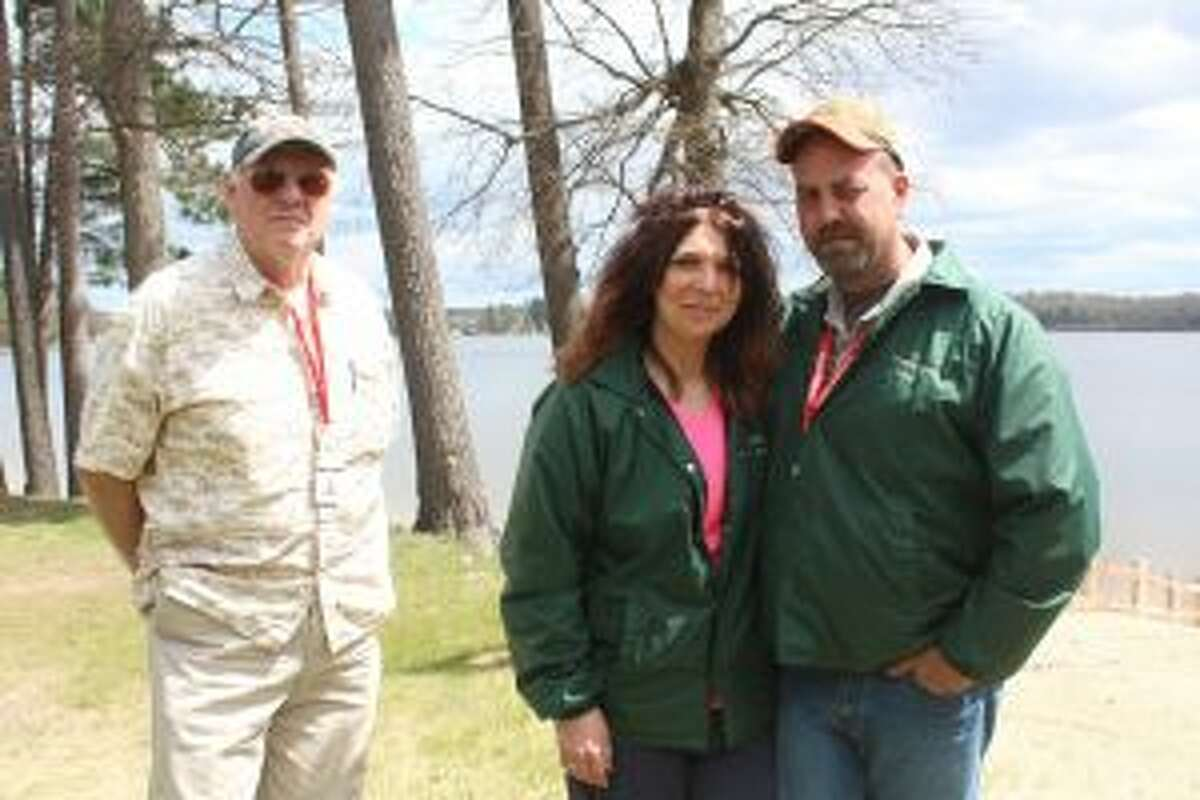 From (left to right) Osceola County Parks Director Carl Baumgras, and Denise and Brian Robertson, managers at Rose Lake Park, are eager for a successful summer season for campers and visitors to Rose Lake and Crittenden parks. The parks open today. (Pioneer photo/Brandon Fountain)