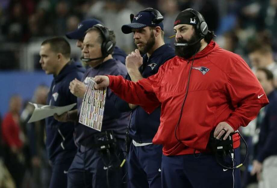 New England Patriots defensive coordinator Matt Patricia, right, calls a play during the second half of the NFL Super Bowl 52 football game against the Philadelphia Eagles, Sunday, Feb. 4, 2018, in Minneapolis. (AP Photo/Frank Franklin II)
